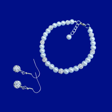 Load image into Gallery viewer, A handmade pearl and crystal bracelet accompanied by a pair of crystal earrings.
