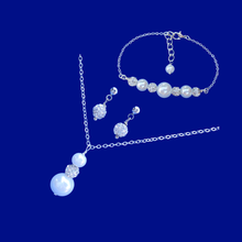 Load image into Gallery viewer, handmade pearl and crystal drop necklace accompanied by a bar bracelet and a pair of crystal stud earrings