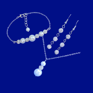 handmade pearl and crystal drop necklace accompanied by a bar bracelet and a pair of multi-strand crystal drop earrings