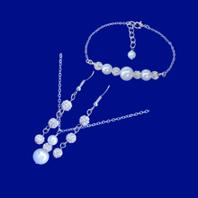 Load image into Gallery viewer, handmade pearl and crystal drop necklace accompanied by a matching bar bracelet and a pair of crystal drop earrings