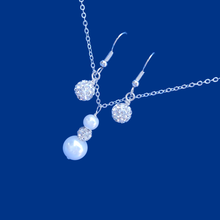 Load image into Gallery viewer,  pearl and crystal drop necklace accompanied by a pair of crystal earrings