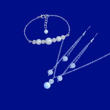 Load image into Gallery viewer, handmade pearl and crystal drop necklace accompanied by a bar bracelet and a pair of multi-strand crystal drop earrings