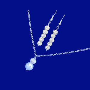 handmade pearl and crystal drop necklace accompanied by a pair of crystal drop earrings