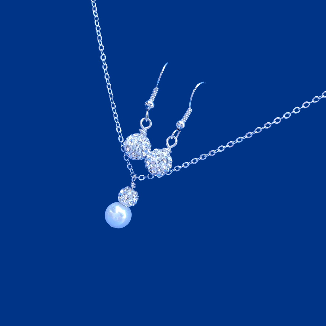 pearl and crystal drop necklace accompanied by a pair of crystal drop earrings