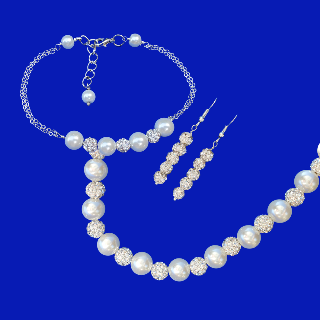 handmade pearl and crystal necklace accompanied by a bar bracelet and a pair of crystal drop earrings