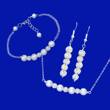 Load image into Gallery viewer, handmade pearl and crystal bar necklace accompanied by a matching bar bracelet and a pair of crystal drop earrings
