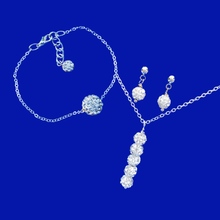 Load image into Gallery viewer, crystal bar necklace accompanied by a floating bracelet and a pair of stud earrings
