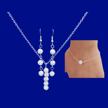 Load image into Gallery viewer, A crystal bar necklace accompanied by a floating bracelet and drop earrings.