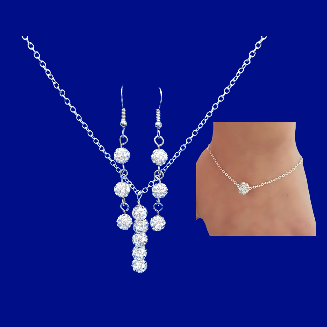 A crystal bar necklace accompanied by a floating bracelet and drop earrings.