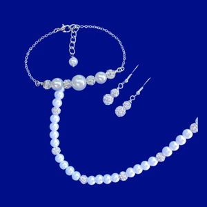 handmade pearl and crystal necklace accompanied by a bar bracelet and a pair of drop earrings