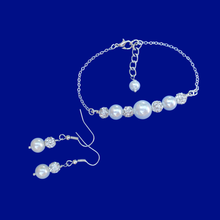 Load image into Gallery viewer, handmade pearl and crystal bar bracelet accompanied by a pair of drop earrings