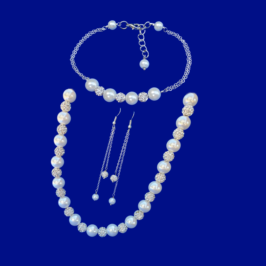 handmade pearl and crystal necklace accompanied by a bar bracelet and a pair of multi-strand drop earrings