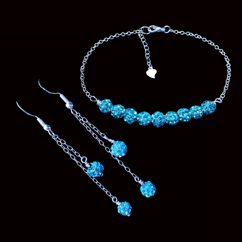 sparkling crystal bar bracelet accompanied by pair of multi-strand drop earrings