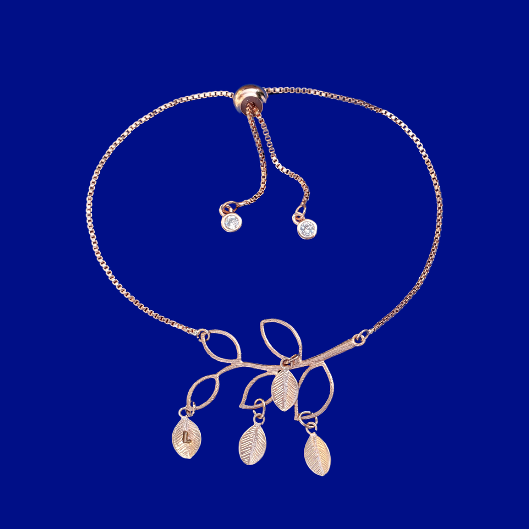 A beautiful handmade 18k family tree leaf charm bracelet. This stunning bracelet will make a gorgeous gift for your mother or grand mother! Each leaf represents the initial of a child or grand child.