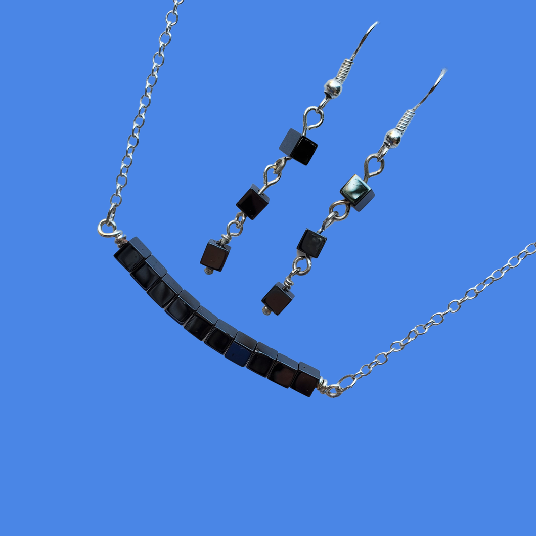 handmade hematite bar necklace accompanied by a pair of drop earrings