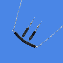 Load image into Gallery viewer, handmade hematite bar necklace accompanied by a pair of drop earrings