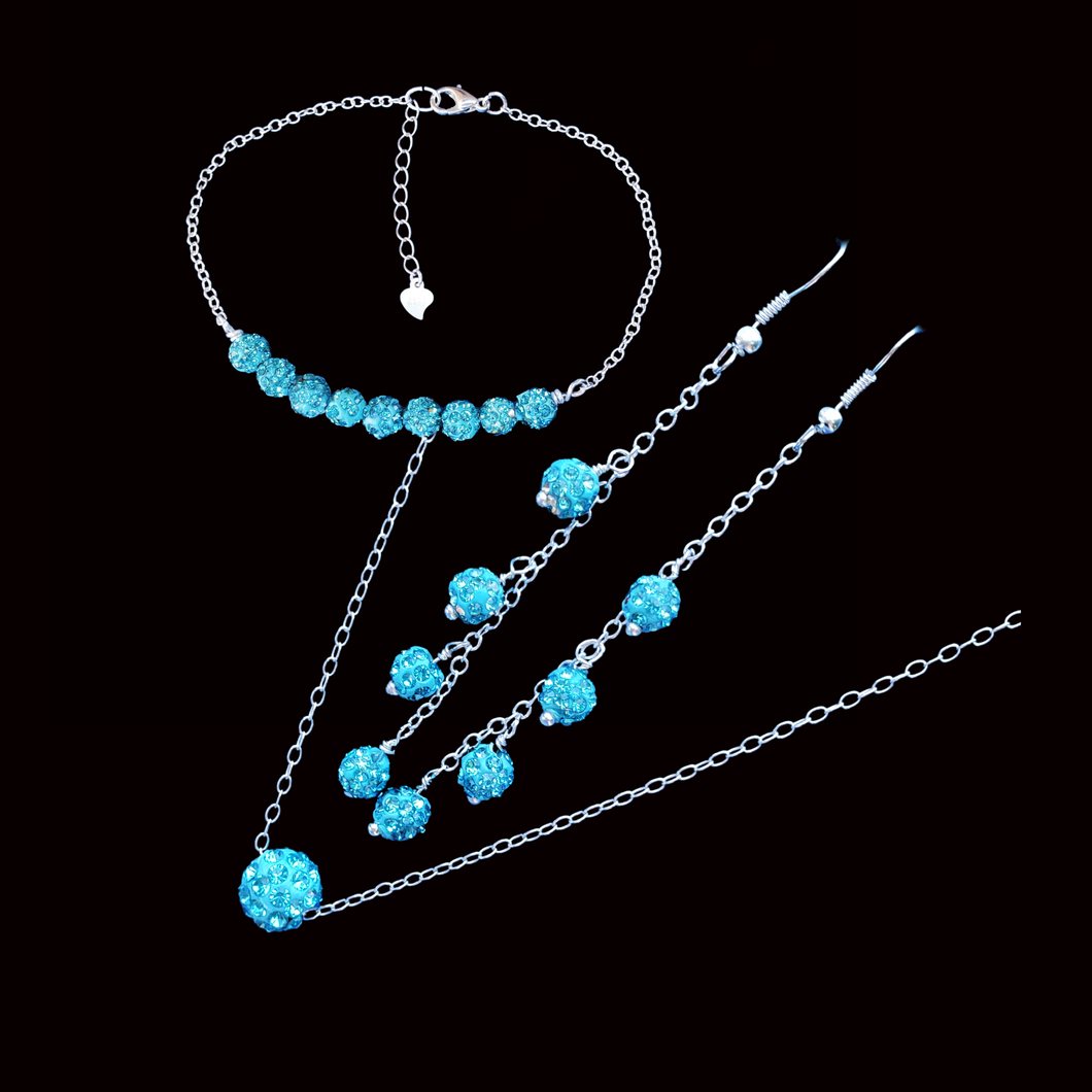 handmade floating crystal necklace accompanied by a bar bracelet and a pair of drop earrings