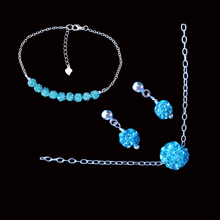Load image into Gallery viewer, handmade floating crystal necklace accompanied by a bar bracelet and a pair of earrings