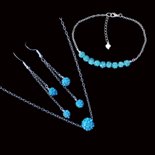Load image into Gallery viewer, handmade floating crystal necklace accompanied by a bar bracelet and a pair of multi-strand drop earrings, aquamarine blue or custom color