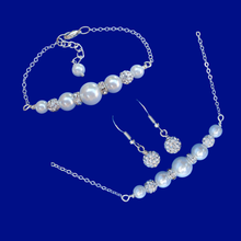 Load image into Gallery viewer, A pearl and crystal bar necklace accompanied by a matching bar bracelet and a pair of crystal earrings.