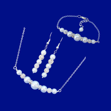 Load image into Gallery viewer, handmade pearl and crystal bar necklace accompanied by a matching bar bracelet and a pair of drop earrings
