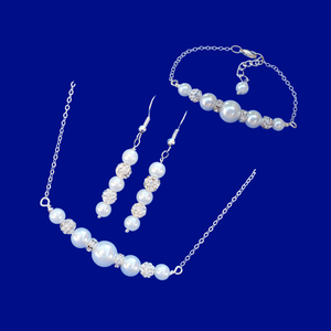 handmade pearl and crystal bar necklace accompanied by a matching bar bracelet and a pair of drop earrings