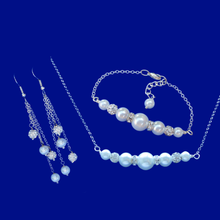 Load image into Gallery viewer, A pearl and crystal bar necklace accompanied by a matching bar bracelet and a pair of multi-strand drop earrings.