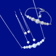 Load image into Gallery viewer, handmade pearl and crystal bar necklace accompanied by a matching bracelet and a pair of multi-strand drop earrings