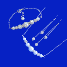 Load image into Gallery viewer, A handmade pearl and crystal bar necklace and bracelet gift set accompanied by a pair of crystal multi-strand drop earrings.