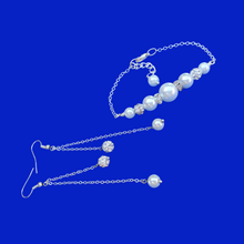 Load image into Gallery viewer, pearl and crystal bar bracelet accompanied by a matching pair of multi-strand drop earrings