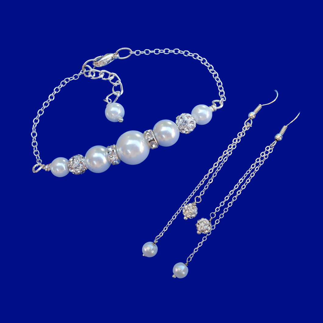 pearl and crystal bar bracelet accompanied by a matching pair of multi-strand drop earrings
