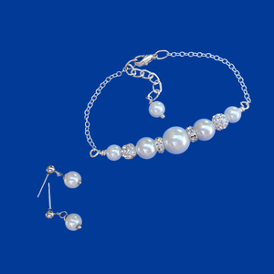 handmade pearl and crystal bar bracelet accompanied by a pair of pearl stud earrings