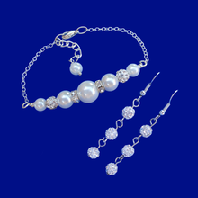 Load image into Gallery viewer, handmade pearl and crystal bar bracelet accompanied by a pair of crystal drop earrings