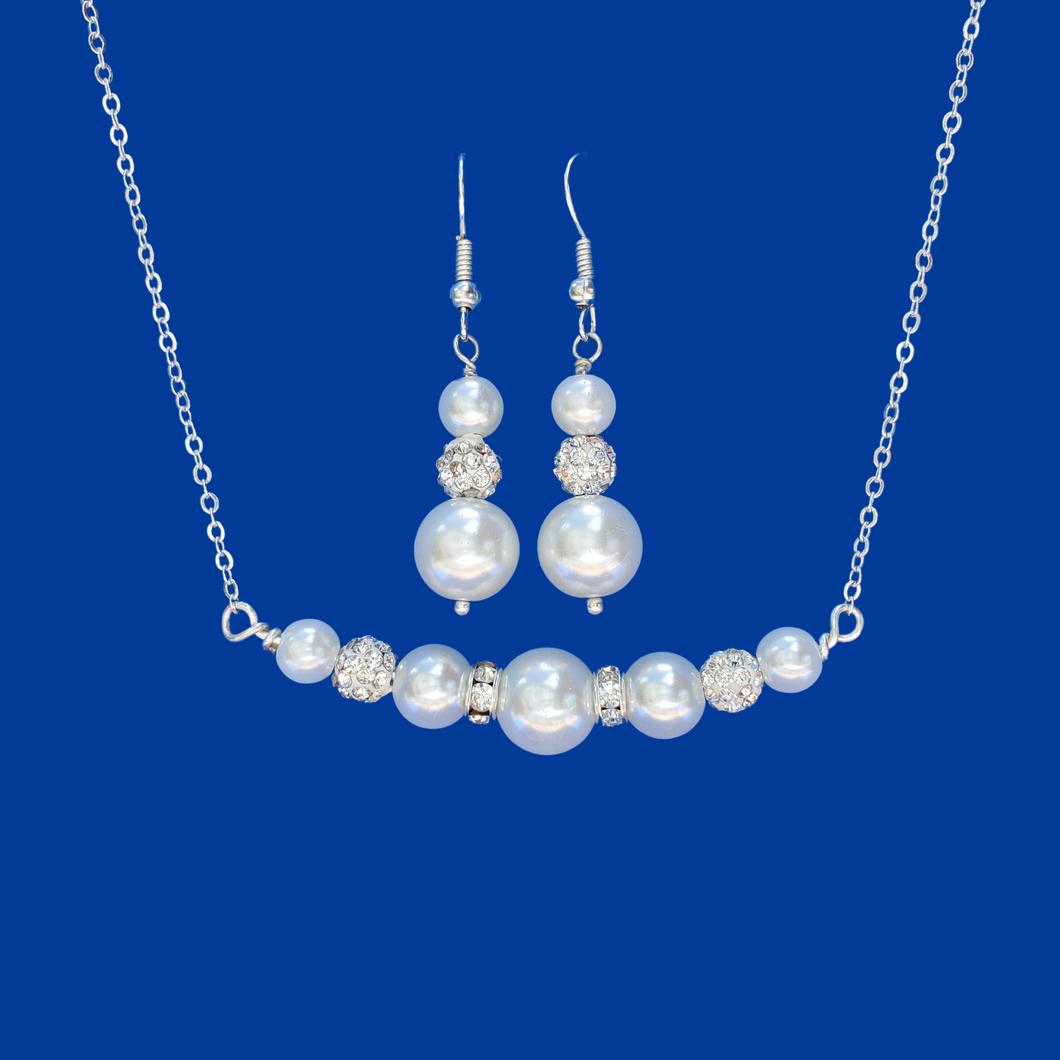 handmade pearl and crystal bar necklace accompanied by a pair of drop earrings