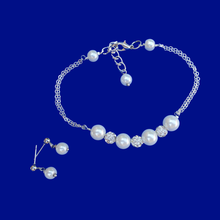Load image into Gallery viewer, A handmade pearl and crystal bar bracelet accompanied by a pair of pearl stud earrings.