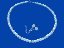 Load image into Gallery viewer, A handmade pearl and crystal necklace accompanied by a pair of crystal earrings.