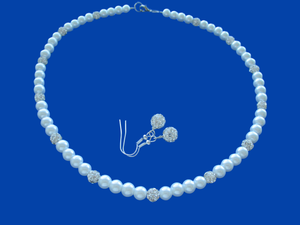 A handmade pearl and crystal necklace accompanied by a pair of crystal earrings.