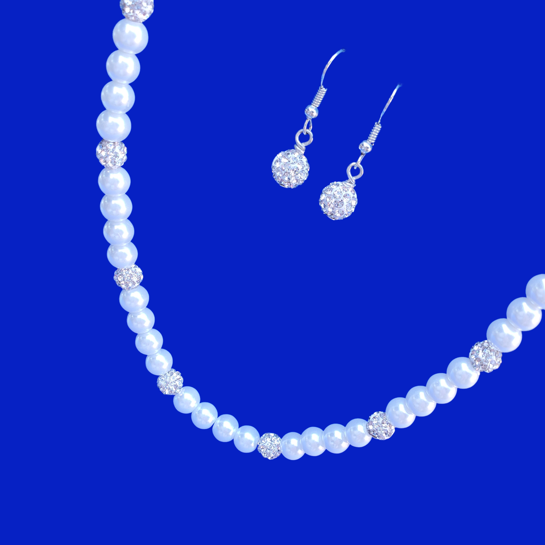 A handmade pearl and crystal necklace accompanied by a pair of crystal drop earrings.