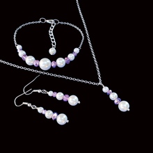 Load image into Gallery viewer, handmade pearl and crystal drop necklace accompanied by a bar bracelet and a pair of drop earrings