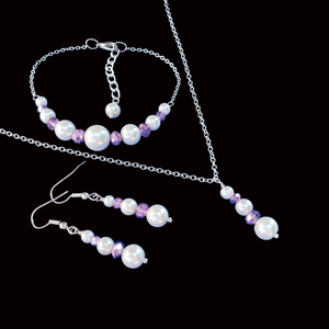 handmade pearl and crystal drop necklace accompanied by a bar bracelet and a pair of drop earrings