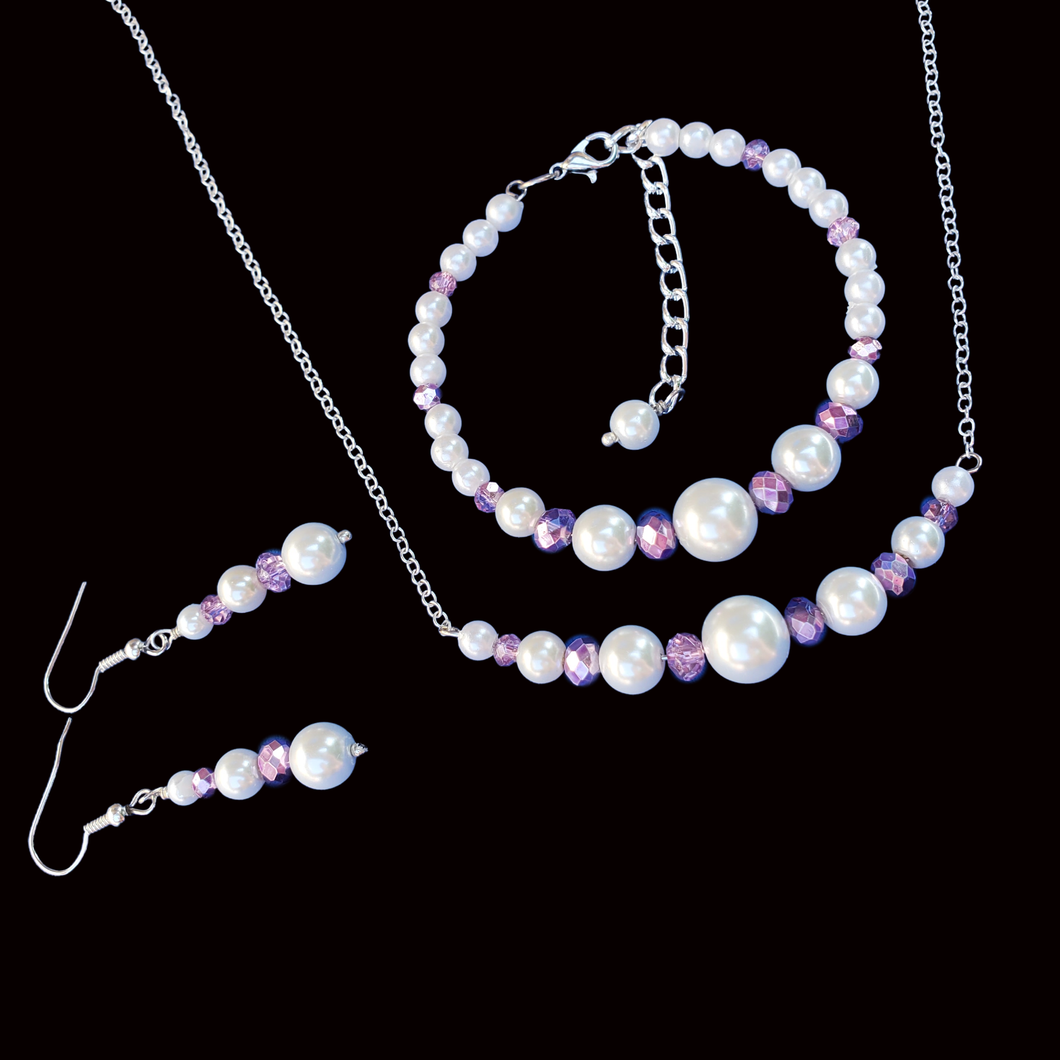 handmade pearl and crystal bar necklace accompanied by a bracelet and a pair of drop earrings