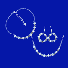 Load image into Gallery viewer, handmade floral fresh water pearl bar necklace accompanied by a matching bracelet and a pair of hoop earrings, ivory and silver or ivory and gold