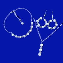 Load image into Gallery viewer, handmade floral fresh water pearl drop necklace accompanied by a bar bracelet and a pair of hoop drop earrings, ivory and gold or ivory and silver