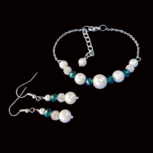 handmade pearl and crystal bar bracelet accompanied by a pair of drop earrings