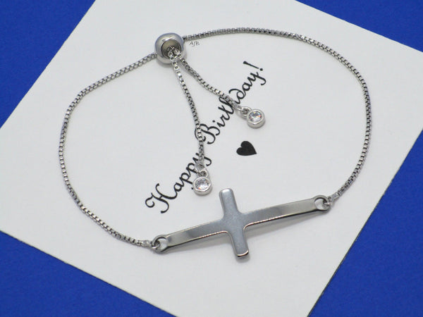 sideways cross on an 18k rhodium adjustable bracelet