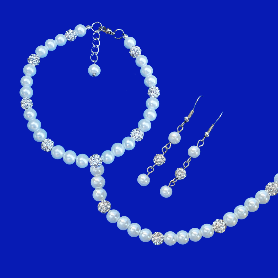 handmade pearl and crystal necklace accompanied by a matching bracelet and a pair of drop earrings