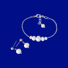 Load image into Gallery viewer, handmade fresh water pearl bar bracelet accompanied by a pair of stud earrings