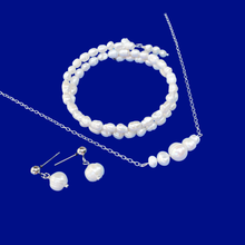 Load image into Gallery viewer, handmade fresh water pearl bar necklace accompanied by an expandable, multi-layer, wrap bracelet and a pair stud earrings