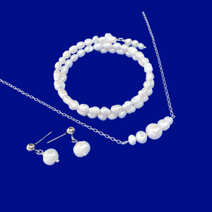 handmade fresh water pearl bar necklace accompanied by an expandable, multi-layer, wrap bracelet and a pair stud earrings