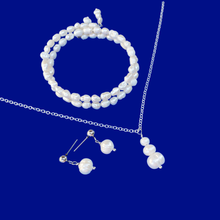 Load image into Gallery viewer, handmade fresh water pearl drop necklace accompanied by an expandable, multi-layer, wrap bracelet and a pair of stud earrings